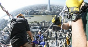 Daredevil fundraisers descend one of London City's tallest peaks.